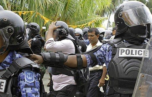 A handout photograph from the Maldivian Democratic Party (MDP) shows Maldivian police officers arresting former Maldives president Mohamed Nasheed (second right) in Fares Maathodaa. Nasheed was detained after he failed to turn up at his trial for abuse of power, his party said
