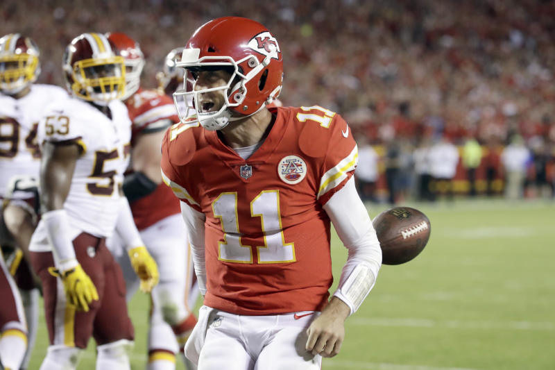 Kansas City Chiefs quarterback Alex Smith celebrates a touchdown against Washington on Monday night. (AP)