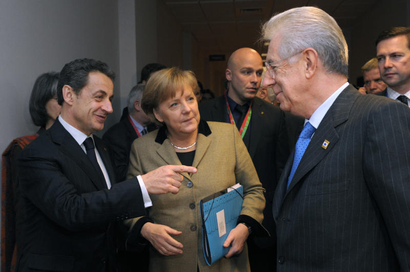 France's President Nicolas Sarkozy, left, Germany's Chancellor Angela Merkel, center, and Italy's Prime Minister Mario Monti speak together prior to a meeting at the European Council in Brussels ahead of the European Union leaders summit, Monday,  Jan. 30, 2012. European leaders were trying Monday to come up with ways to boost economic growth and jobs, which are being squeezed by their own governments' steep budget cuts across the continent.  (AP Photo/Philippe Wojazer, pool) FRANCE MAGS OUT