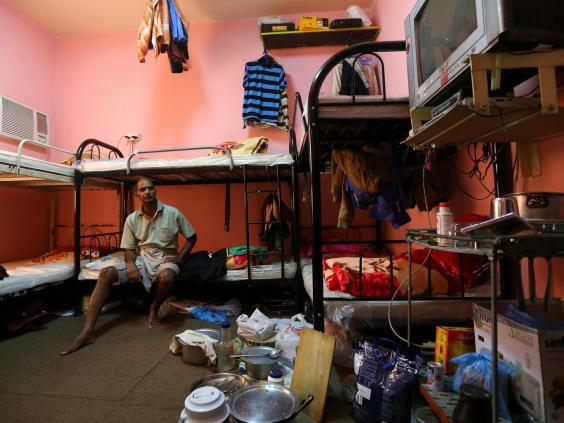 A Qatar worker in his shared accommodation (Getty)
