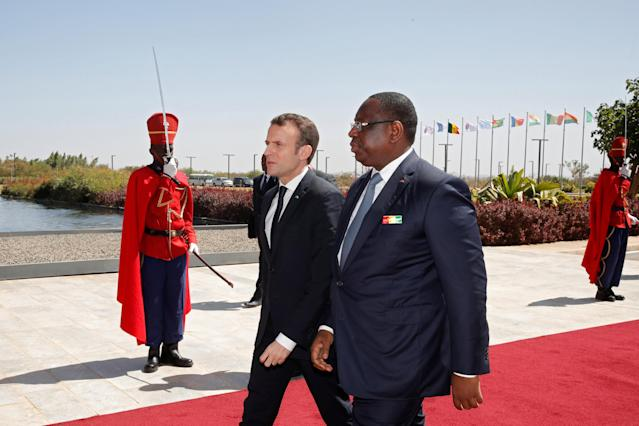Senegalese President Macky Sall and French President Emmanuel Macron arrive at the World Partnership for Education in Dakar, Senegal, February 2, 2018. REUTERS/Philippe Wojazer
