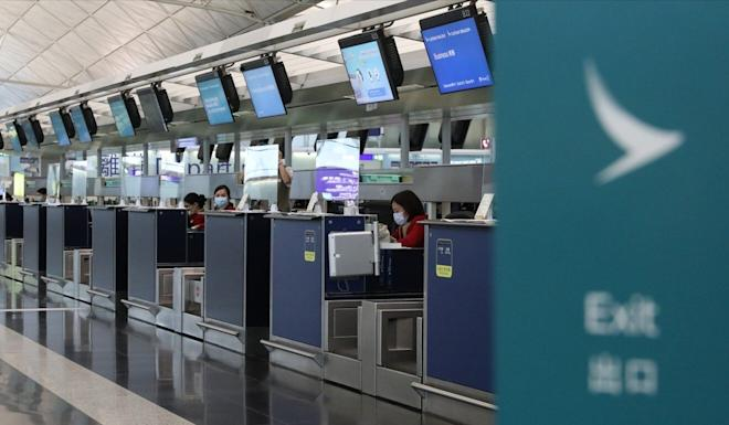 Cathay Pacific staff man quiet counters at Hong Kong International Airport on August 12. Photo: Nora Tam