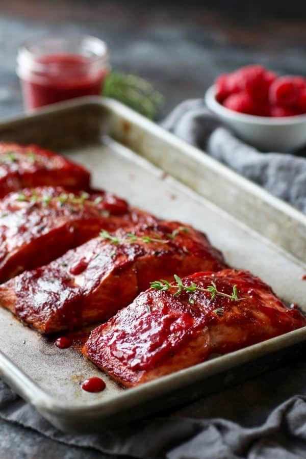 """<p>Healthy, filling, and oh-so-easy to cook, this raspberry-infused spin on standard salmon will have party guests begging for your recipe.</p><p><strong>Get the recipe at <a href=""""https://therealfoodrds.com/raspberry-balsamic-glazed-salmon-whole30/"""" rel=""""nofollow noopener"""" target=""""_blank"""" data-ylk=""""slk:The Real Food Dietitians"""" class=""""link rapid-noclick-resp"""">The Real Food Dietitians</a>. </strong> </p>"""