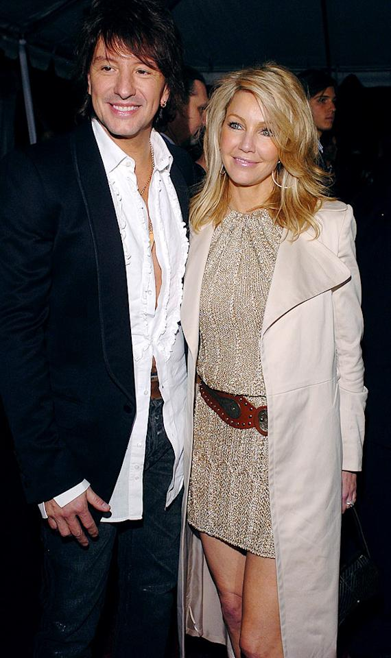 """Actress Heather Locklear was shot through the heart when she met Bon Jovi guitarist Richie Sambora, and the two quickly settled into a happy -- if cliche -- actress/rocker relationship (Locklear previously had been married to Tommy Lee). The pair wed in Paris in late '94, and had a daughter, Ava, a few years later. But in 2006 the """"Melrose Place"""" star packed her bags. L. Cohen/<a href=""""http://www.wireimage.com"""" target=""""new"""">WireImage.com</a> - February 11, 2005"""