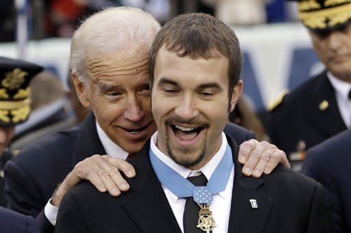 Vice President Joe Biden meets with Salvatore Giunta a recipient of the Medal of Honor before an NCAA college football game between the Army and the Navy, Saturday, Dec. 8, 2012, in Philadelphia. (AP Photo/Matt Rourke)