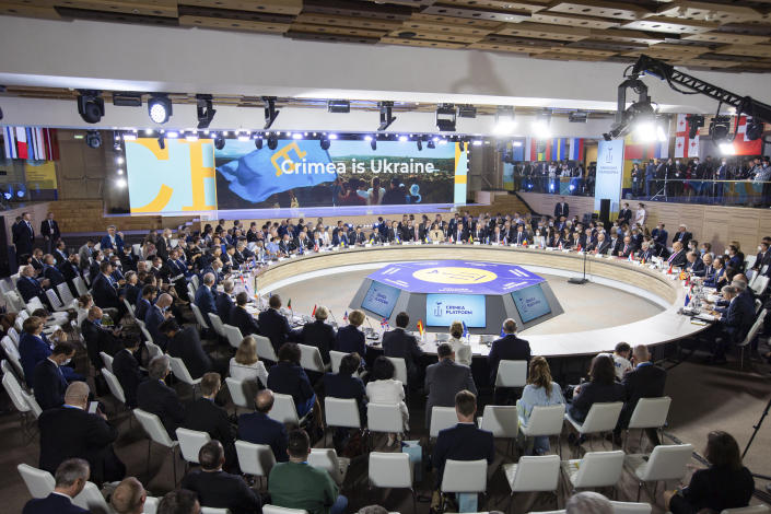 High ranking officials attend the Crimea Platform summit in Kyiv, Ukraine, Monday, Aug. 23, 2021. The Crimean Platform, an international summit called by Ukraine to build up pressure on Russia over the annexation that has been denounced as illegal by most of the world, opened in Kyiv on Monday. (Ukrainian Presidential Press Office via AP)