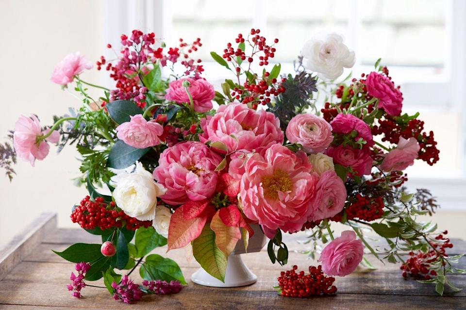 "<p>Lovely pink hues can make a statement in just about any holiday centerpiece, but is decidedly ""Christmas"" when paired with tiny red berry sprigs. </p><p><em>Via <a href=""http://tulipina.com/"" rel=""nofollow noopener"" target=""_blank"" data-ylk=""slk:Tulipina"" class=""link rapid-noclick-resp"">Tulipina</a> </em></p>"