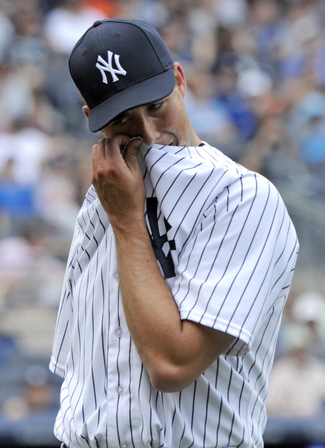 New York Yankees pitcher Jeff Francis reacts as he walks off the field after giving up a three-run home run to Toronto Blue Jays' Dan Johnson during the ninth inning a baseball game on Saturday, July 26, 2014, at Yankee Stadium in New York. The Blue Jays won 6-4. (AP Photo/Bill Kostroun)