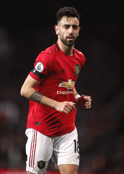 Manchester United's Bruno Fernandes runs, during the English Premier League soccer match between Manchester United and Wolverhampton Wanderers, at Old Trafford, in Manchester, England, Saturday, Feb. 1, 2020. (Martin Rickett/PA via AP)
