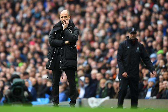 <p>Pep Guardiola looks on, concerned </p>