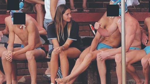 Fiona Viotti, 32, pictured seated beside water polo students with their faces blacked out. Source: Facebook