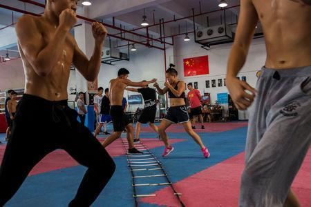 Huang Wensi in action during her final training session in Ningbo, Zhejiang province, China, before she heads to Taiwan for her Asia Female Continental Super Flyweight Championship match, September 23, 2018. REUTERS/Yue Wu