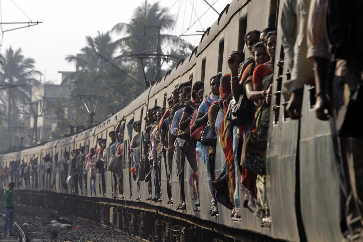 Indian commuters travel in a local train in Kolkata, India.