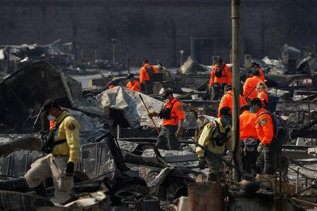 Urban Search and Rescue teams search for two missing people amongst ruins at Journey's End Mobile Home Park destroyed by the Tubbs Fire in Santa Rosa, California