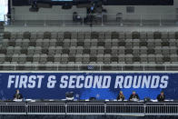A section of seats at the Indiana Farmers Coliseum sit empty during a first round NCAA college basketball tournament game Friday, March 19, 2021, between Drexel and Illinois in Indianapolis. No bands. No cheer squad. No buildings filled with neutral fans suddenly throwing their support behind a plucky double-digit underdog hoping to pull off an upset. This is a decidedly different NCAA tournament experience for players and coaches when they get on the court. (AP Photo/Charles Rex Arbogast)