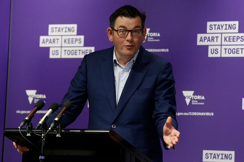 MELBOURNE, AUSTRALIA - SEPTEMBER 20: Victorian Premier Daniel Andrews speaks at the daily briefing on September 20, 2020 in Melbourne, Australia. Victoria has recorded 14 new coronavirus cases and five deaths in the past 24 hours, the second day in a row of daily new cases under 30 after 21 cases were recorded on Saturday. It is the lowest case numbers for Victoria since June 24 where 20 cases were reported. Metropolitan Melbourne remains under stage 4 lockdown restrictions, with people only allowed to leave home to give or receive care, shopping for food and essential items, daily exercise and work while an overnight curfew from 8pm to 5am is also in place. The majority of retail businesses are also closed. Other Victorian regions are in stage 3 lockdown. The restrictions, which came into effect from 2 August, were introduced by the Victorian government as health authorities work to reduce community COVID-19 transmissions across the state. (Photo by Darrian Traynor/Getty Images) (Photo: Darrian Traynor via Getty Images)