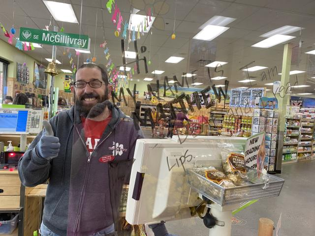 Trader Joe's employee who is deaf is using a customized T-shirt and white boards to communicate with mask-wearing customers. (Photo courtesy of Matthew Simmons)