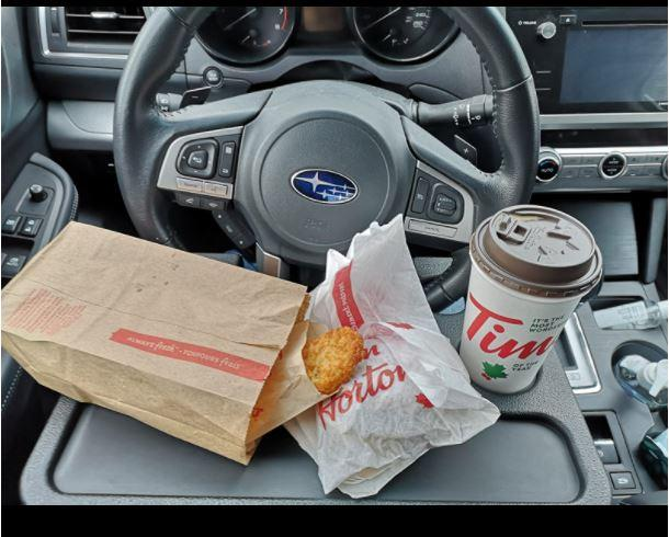 I'm obsessed with this $19 car tray from Amazon Canada.