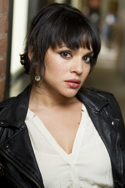 """In this April 9, 2012 photo, singer Norah Jones poses for a portrait in New York. Jones' latest album, """"Little Broken Hearts,"""" was released on May 1. (AP Photo/Charles Sykes)"""