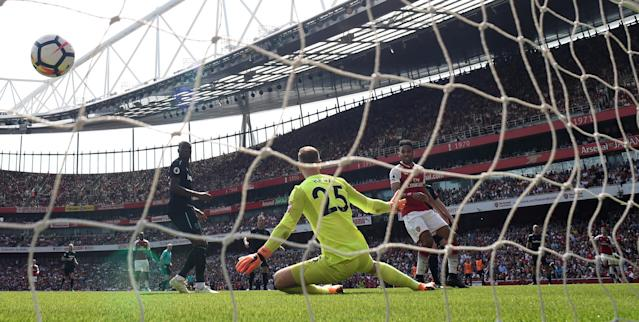 """Soccer Football - Premier League - Arsenal v West Ham United - Emirates Stadium, London, Britain - April 22, 2018 Arsenal's Aaron Ramsey (R) scores their second goal Action Images via Reuters/Tony O'Brien EDITORIAL USE ONLY. No use with unauthorized audio, video, data, fixture lists, club/league logos or """"live"""" services. Online in-match use limited to 75 images, no video emulation. No use in betting, games or single club/league/player publications. Please contact your account representative for further details."""