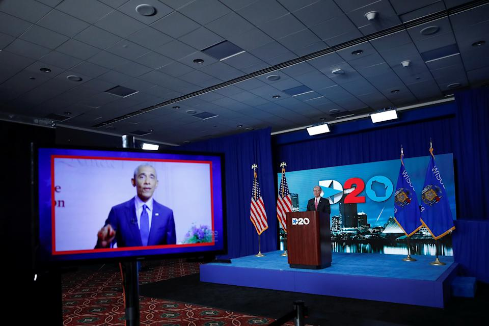 A screen plays a video of former president Barack Obama as Chairman of the Democratic National Committee Tom Perez waits to speak during the virtual Democratic National Convention in Milwaukee, Wisconsin, August 20, 2020.   Kamil Krzaczynski/Pool via REUTERS