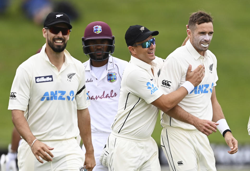 New Zealand's Tim Southee, right, is congratulated by teamates after dismissing the West Indies' John Campbell during play on day three of their first cricket test in Hamilton, New Zealand, Saturday, Dec. 5, 2020. (Andrew Cornaga/Photosport via AP)