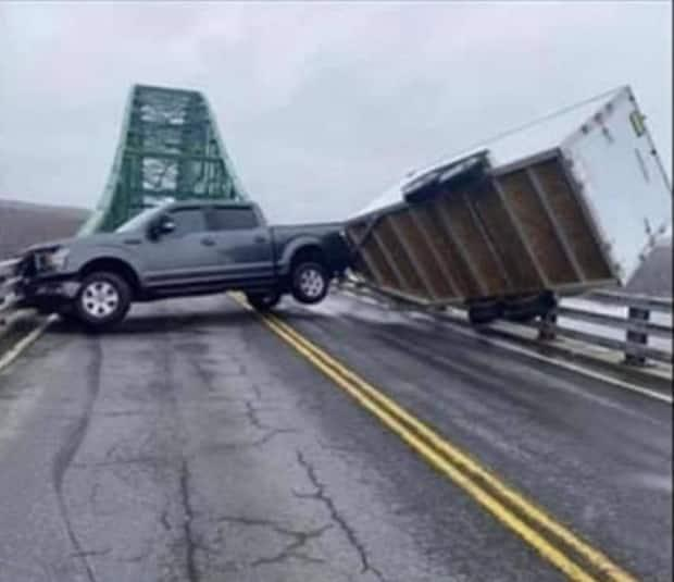 RCMP say high winds caused a pickup truck and trailer has become stuck on the Seal Island Bridge.  (Submitted by Rhonda Lockhart - image credit)