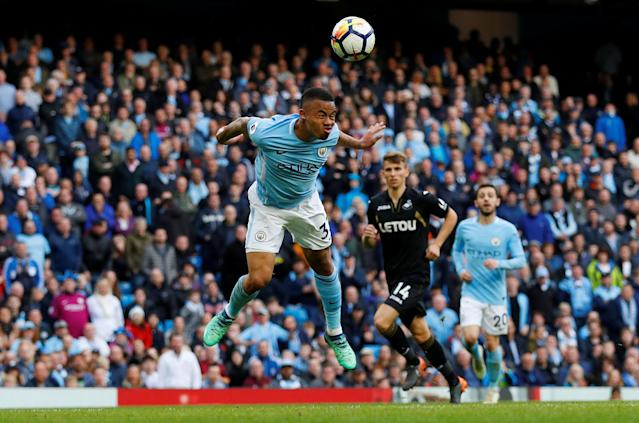 "Soccer Football - Premier League - Manchester City v Swansea City - Etihad Stadium, Manchester, Britain - April 22, 2018 Manchester City's Gabriel Jesus scores their fifth goal REUTERS/Phil Noble EDITORIAL USE ONLY. No use with unauthorized audio, video, data, fixture lists, club/league logos or ""live"" services. Online in-match use limited to 75 images, no video emulation. No use in betting, games or single club/league/player publications. Please contact your account representative for further details."