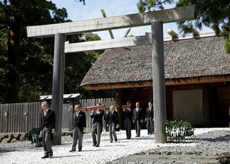 FILE PHOTO: Japan's Emperor Akihito, flanked by Imperial Household Agency officials carrying two of the so-called Three Sacred Treasures of Japan, leaves the main sanctuary as he visits the Inner shrine of the Ise Jingu shrine, ahead of his April 30, 2019 abdication, in Ise, Japan, April 18, 2019. REUTERS/Issei Kato/File Photo