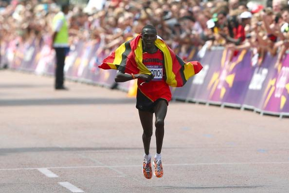 LONDON, ENGLAND - AUGUST 12:  Stephen Kiprotich of Uganda celebrates as he approaches the line to win gold in the Men's Marathon on Day 16 of the London 2012 Olympic Games at The Mall on August 12, 2012 in London, England.  (Photo by Michael Steele/Getty Images)