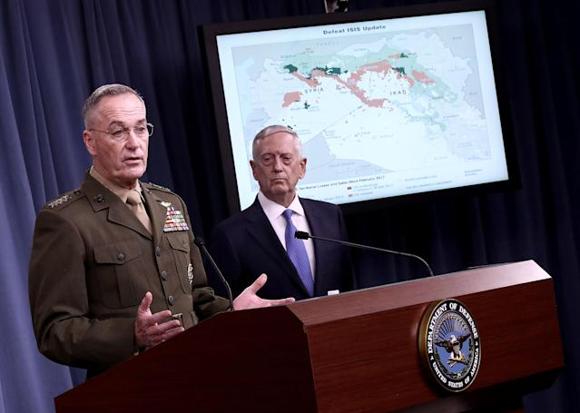 Chairman of the Joint Chiefs of Staff Marine Gen. Joseph F. Dunford Jr., left, and U.S. Secretary of Defense Jim Mattisanswer questions during a Pentagon briefing, May 19, 2017. (Photo: Win McNamee/Getty Images)