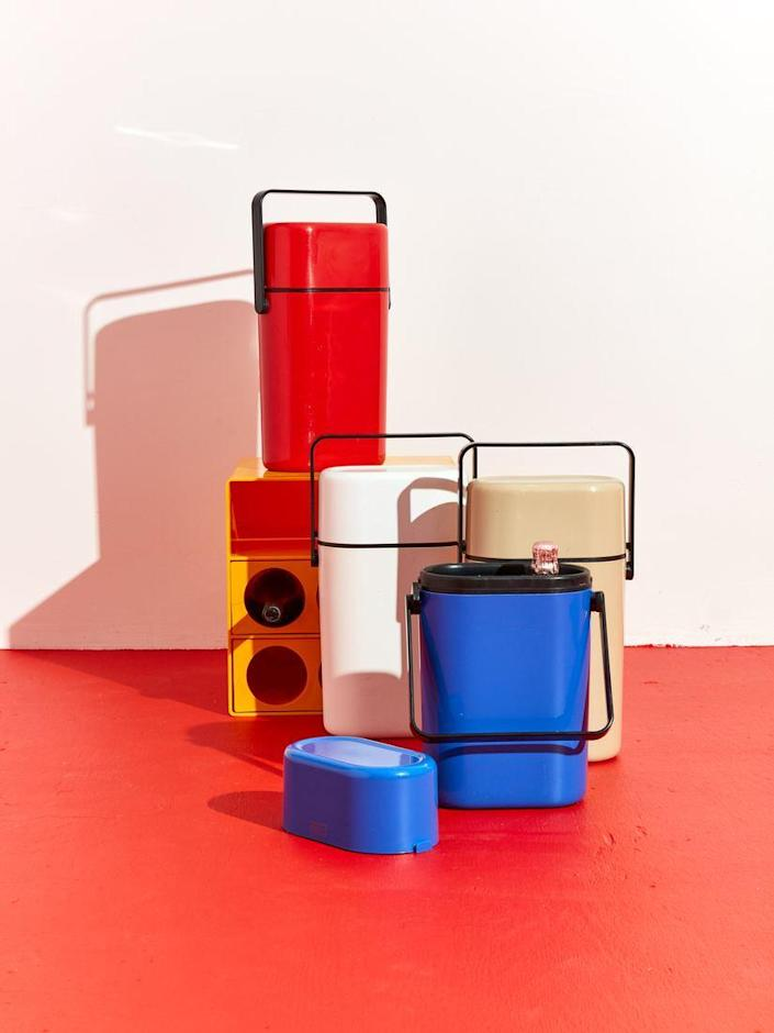 """Ice bucket–adjacent, these vintage wine coolers are perfect for taking your party to the deck, park, and beyond. The bright primary colors are divine. $220, Coming Soon. <a href=""""https://comingsoonnewyork.com/products/vintage-travel-wine-cooler"""" rel=""""nofollow noopener"""" target=""""_blank"""" data-ylk=""""slk:Get it now!"""" class=""""link rapid-noclick-resp"""">Get it now!</a>"""