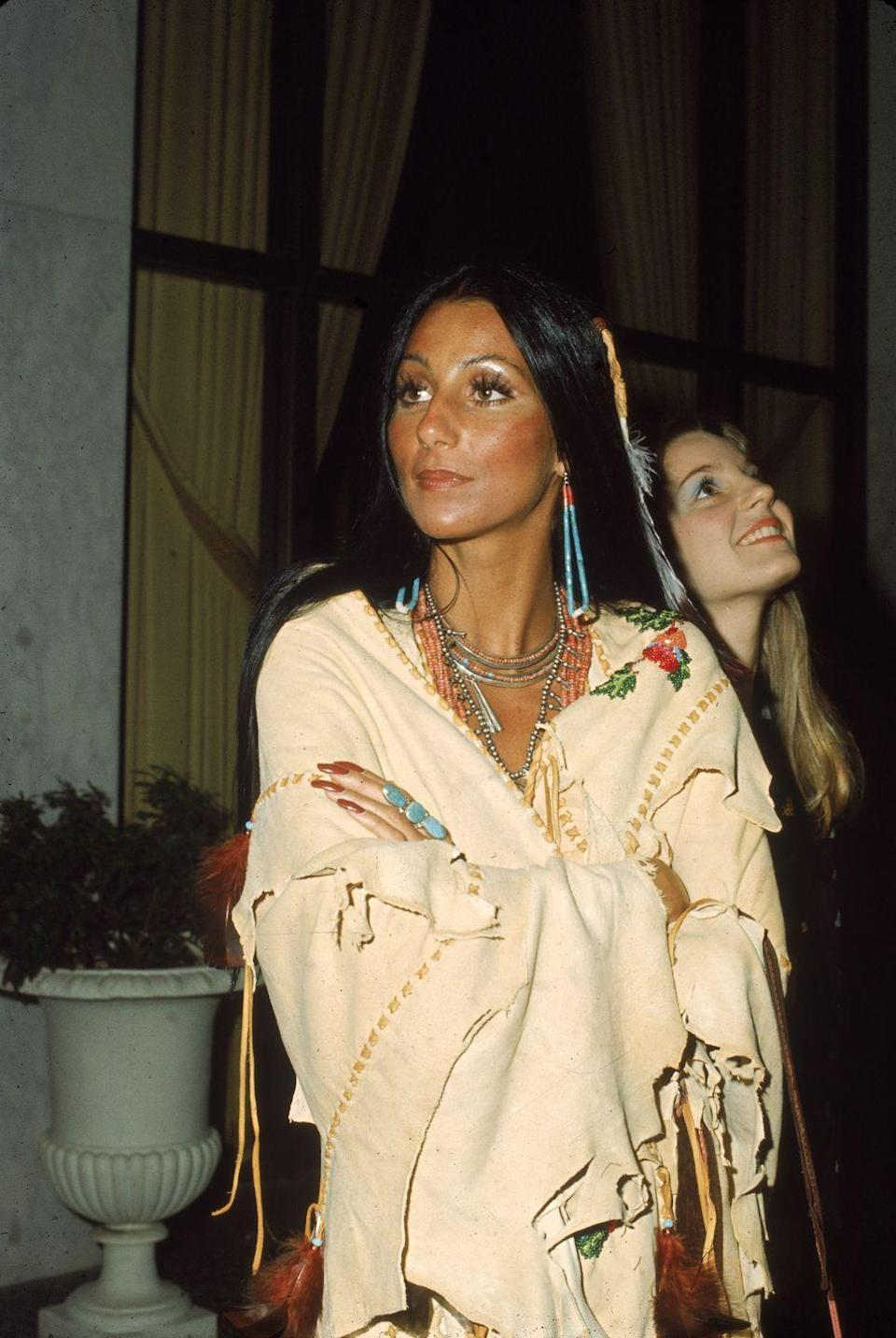 <p>Attending the premiere of <em>Last Tango in Paris</em> in an embroidered poncho and turquoise jewelry. </p>