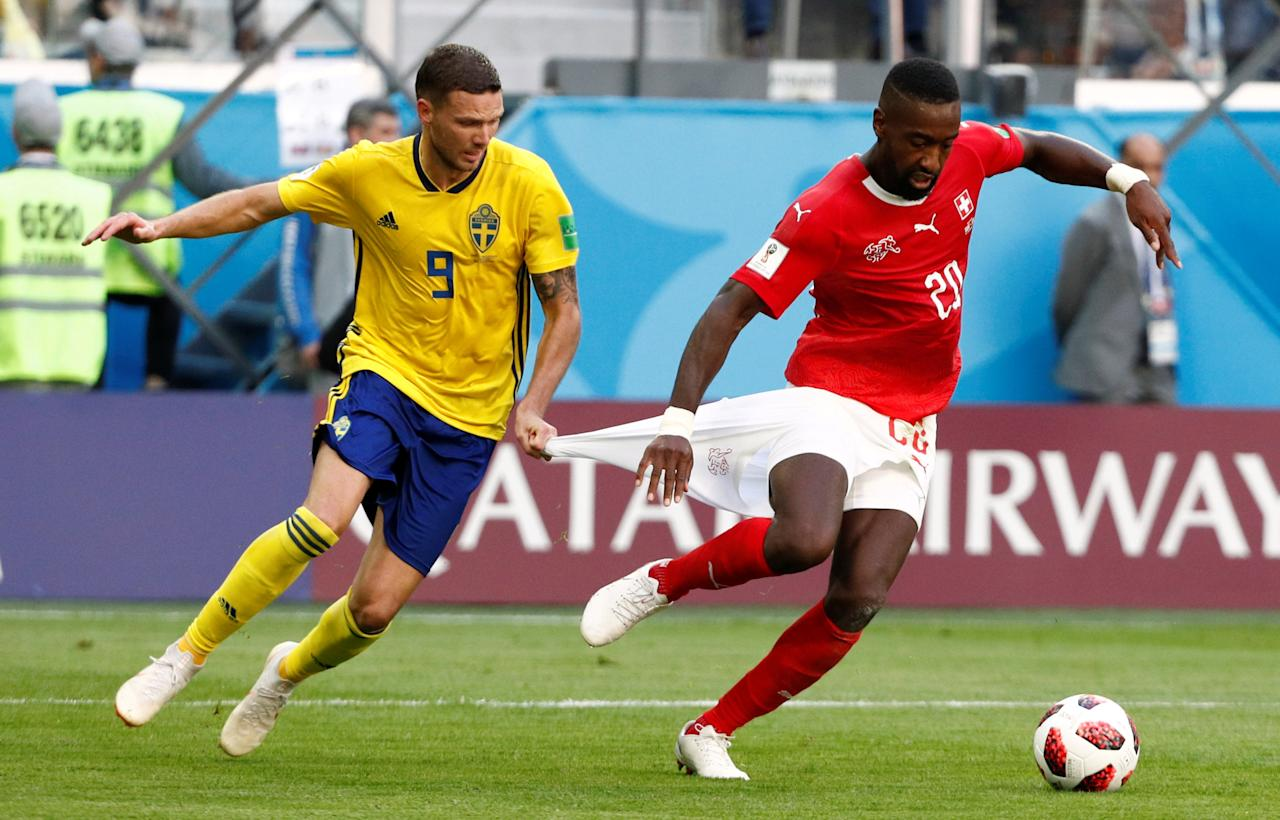 <p>Switzerland's Johan Djourou in action with Sweden's Marcus Berg REUTERS/Max Rossi </p>