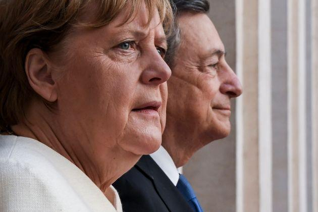 ROME, ITALY - OCTOBER 7: Italian Prime Minister Mario Draghi meets the German Chancellor Angela Merkel before their meeting at Palazzo Chigi, on October 7, 2021 in Rome, Italy. Outgoing German Chancellor Angela Merkel will meet with Italian Prime Minister Draghi on a farewell visit. Merkel and Draghi will join Pope Francis and other religious leaders in praying for peace at the Colosseum. (Photo by AM POOL/Getty Images) (Photo: AM POOL via Getty Images)