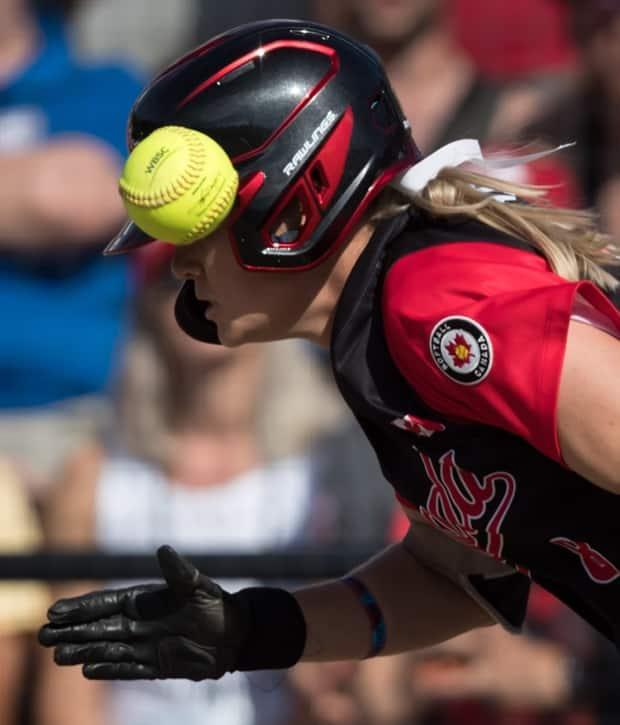 Canada's Victoria Hayward runs to first for a single on a bunt during first inning playoff action against Brazil at the 2019 Softball Americas Olympic Qualifier tournament in Surrey, B.C. (Darryl Dyck/The Canadian Press  - image credit)