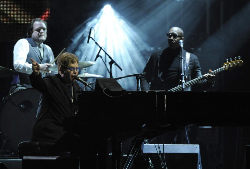 "Elton John performs ""Streets of Philadelphia"" at the MusiCares Person of the Year tribute honoring Bruce Springsteen at the Los Angeles Convention Center on Friday Feb. 8, 2013, in Los Angeles. (Photo by Chris Pizzello/Invision/AP)"