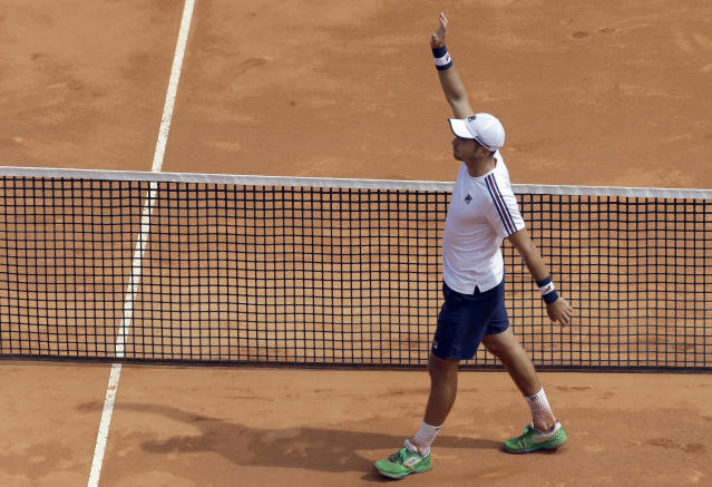 Serbia's Dusan Lajovic celebrates after defeating Russia's Daniil Medvedev during their semifinal match of the Monte Carlo Tennis Masters tournament in Monaco, Saturday, April, 20, 2019. (AP Photo/Claude Paris)