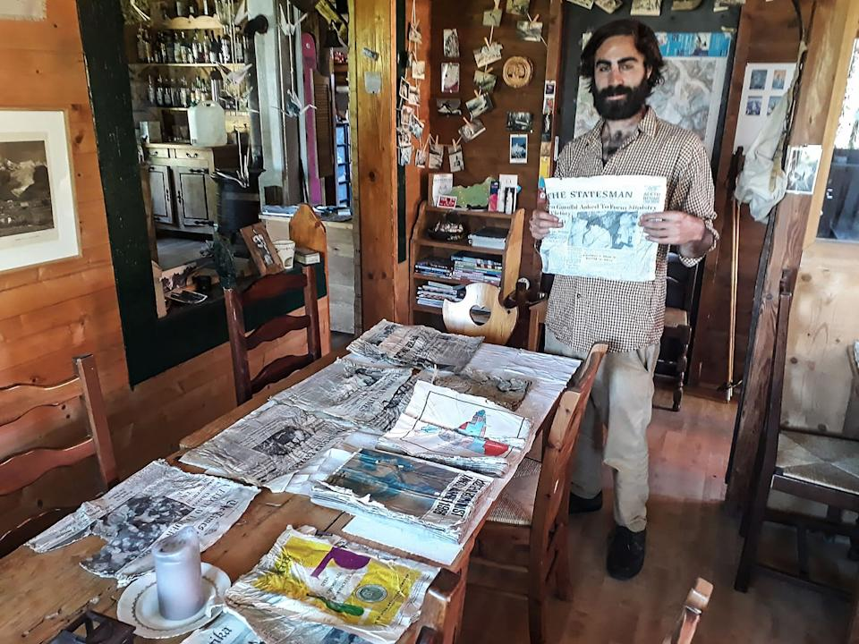 Thimotee Mottin, manager  Cabane du Cerro near the Bossons glacier, poses with copies of Indian newspapers likely to have been on board the Air India Boeing 707 in 1966.  Source: AFP/Getty Images