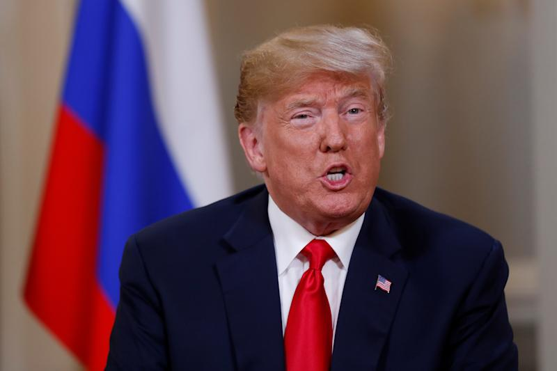 Trump at a press conference with Putin after their meeting in Helsinki, July 16, 2018. Trump backed Putin's denial of interference in the 2016 presidential election, contrary to U.S. intelligence agencies' conclusions. (Kevin Lamarque / Reuters)