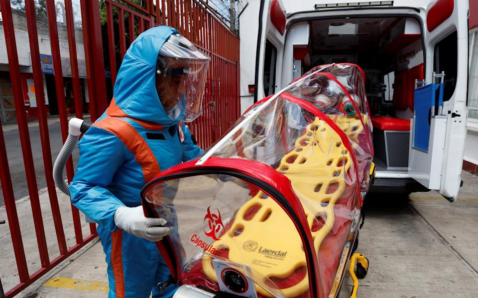 ) A paramedic of the company XE Ingenieria Medica presents a suit to work with Covid-19 patients, in Mexico City. The inflate suit was inspired in tv show Star Trek, said Director of the company XE Ingenieria Medica Fernando Aviles - Jose Mendez/EPA-EFE/Shutterstock