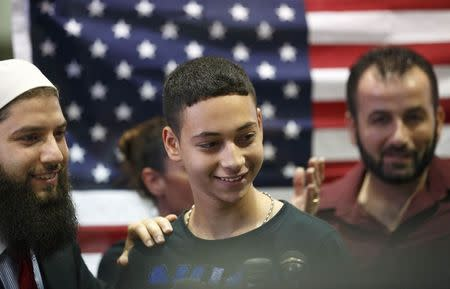 Florida teenager Tariq Khdeir is greeted by family members after his arrival from Israel at Tampa airport