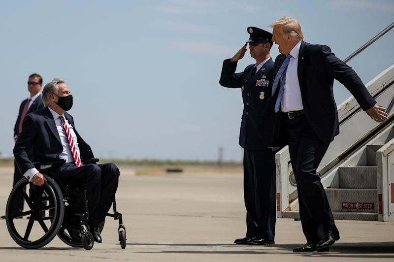 Donald Trump is greeted by governor Greg Abbott on a visit to Texas: REUTERS