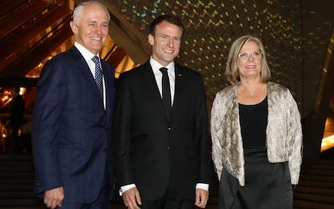 <span>Emmanuel Macron poses with Malcolm Turnbull and his wife Lucy Turnbull outside the Sydney Opera House </span> <span>Credit: AFP </span>