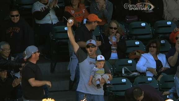 Casual and calm Giants fan snatches foul ball while holding baby (Video)