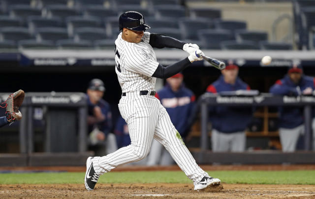 New York Yankees' Gleyber Torres, who was called up Sunday, hits an eighth inning single, his first major league hit, during a baseball game against the Minnesota Twins in New York, Monday, April 23, 2018. (AP Photo/Kathy Willens)