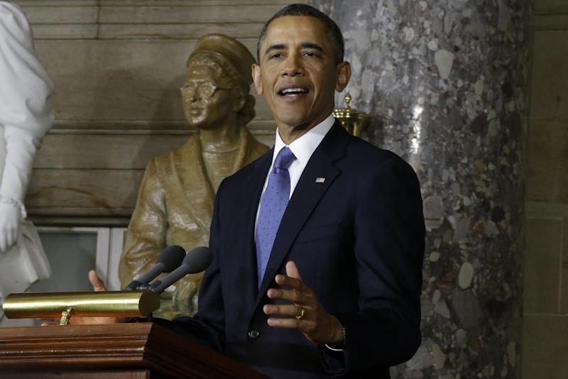President Barack Obama speaks at the unveiling of a statue of Rosa Parks, left, Wednesday, Feb. 27, 2013, on Capitol Hill in Washington. (AP Photo/Charles Dharapak)