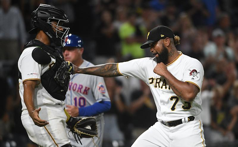 PITTSBURGH, PA - AUGUST 02: Felipe Vazquez #73 of the Pittsburgh Pirates celebrates with Elias Diaz #32 after the final out in an 8-4 win over the New York Mets at PNC Park on August 2, 2019 in Pittsburgh, Pennsylvania. (Photo by Justin Berl/Getty Images)