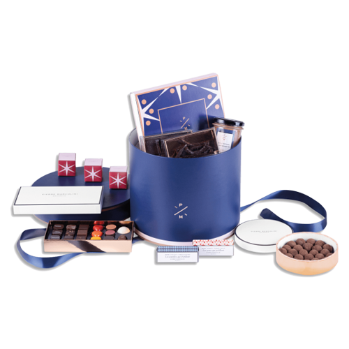 """<p><a class=""""link rapid-noclick-resp"""" href=""""https://eu.marcolini.com/en/product/large-christmas-hatbox/"""" rel=""""nofollow noopener"""" target=""""_blank"""" data-ylk=""""slk:SHOP"""">SHOP</a></p><p>Pierre will sort you out. The Belgian chocolatier has pulled together a hatbox which, gratefully, has eschewed headwear for *takes a deep, deep breath* 36 Christmas Petits Câlins, a plumier découverte, a box of 15 truffles du jour, Casse-Noisette spread, a box of six macarons, a box of orangettes, a box of vanilla marshmallows, a chocolate gianduja nougat barre, a chocolate caramel vanilla barre and three individual Christmas demi-lunes.</p><p>Designed for dessert, more likely to be picked at by everyone throughout the morning, ruining Christmas dinner in the most delicious way possible.</p>"""