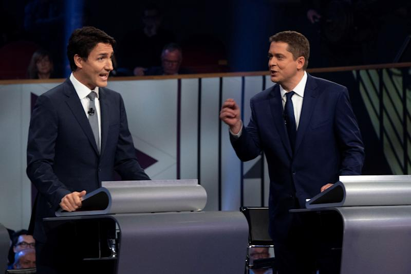 Liberal leader Justin Trudeau and Conservative leader Andrew Scheer disagree on Canada's economic path forward (REUTERS)